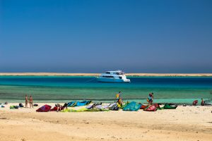 Kite yacht in the Red Sea in Egypt with kites lying on the beach